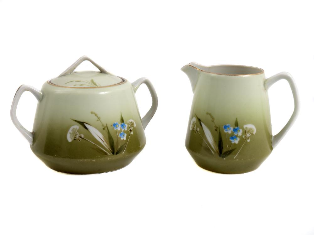 AN EARLY SOVIET PORCELAIN CREAMER AND SUGAR BOWL