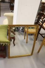 Early 20th cent. Gilt framed gesso mirror 24ins x 33ins.
