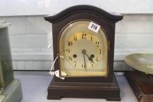 Clocks: Oak cased German mantle clock domed door made by Junghans.