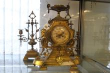 19th cent. Gilt brass Neo Classical style garniture comprising mantle clock
