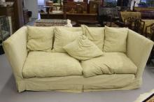 20th cent. Four seater sofa with loose covers.