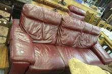20th cent. 2010 red leather three seater sofa, reclining end seats.