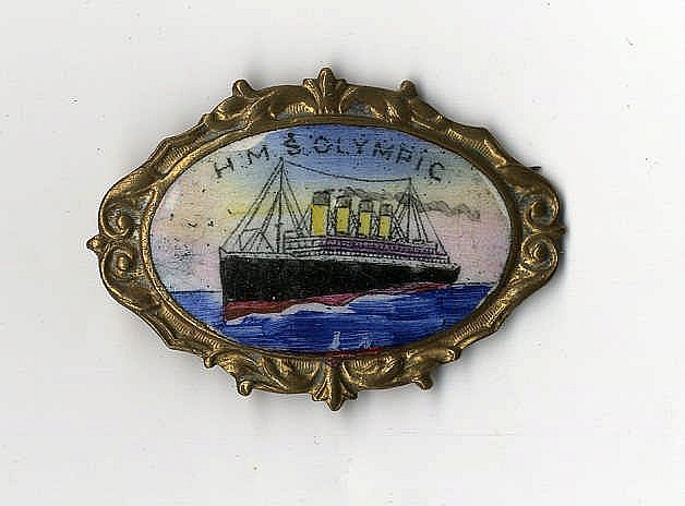 R.M.S. OLYMPIC: Unusual oval gilt enamel brooch showing H.M.S Oly