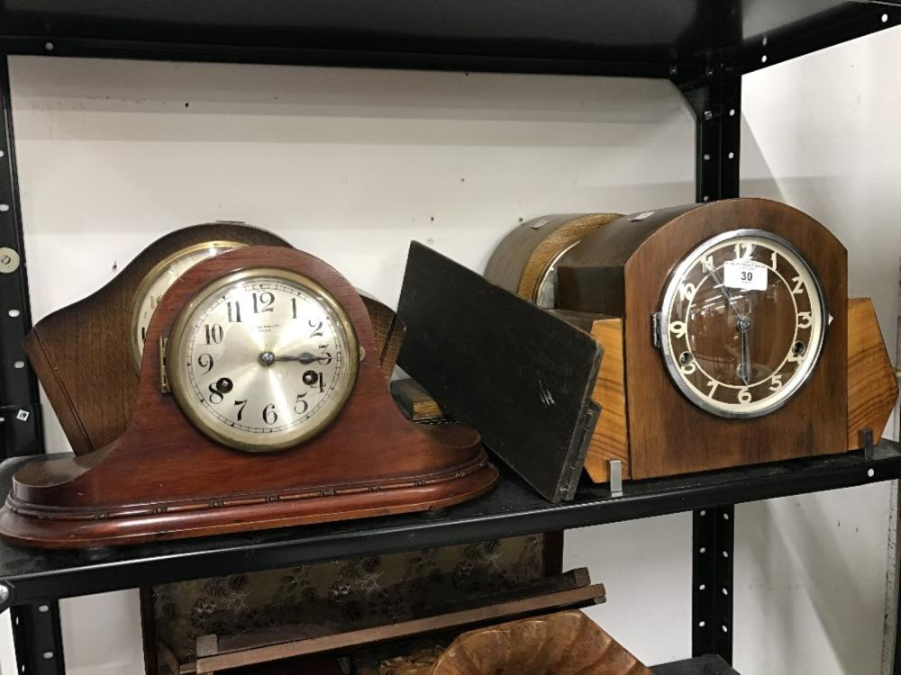 Clocks: Mantle clocks. Two Smiths clocks one Napoleon hat shaped and one art deco form, foreign make