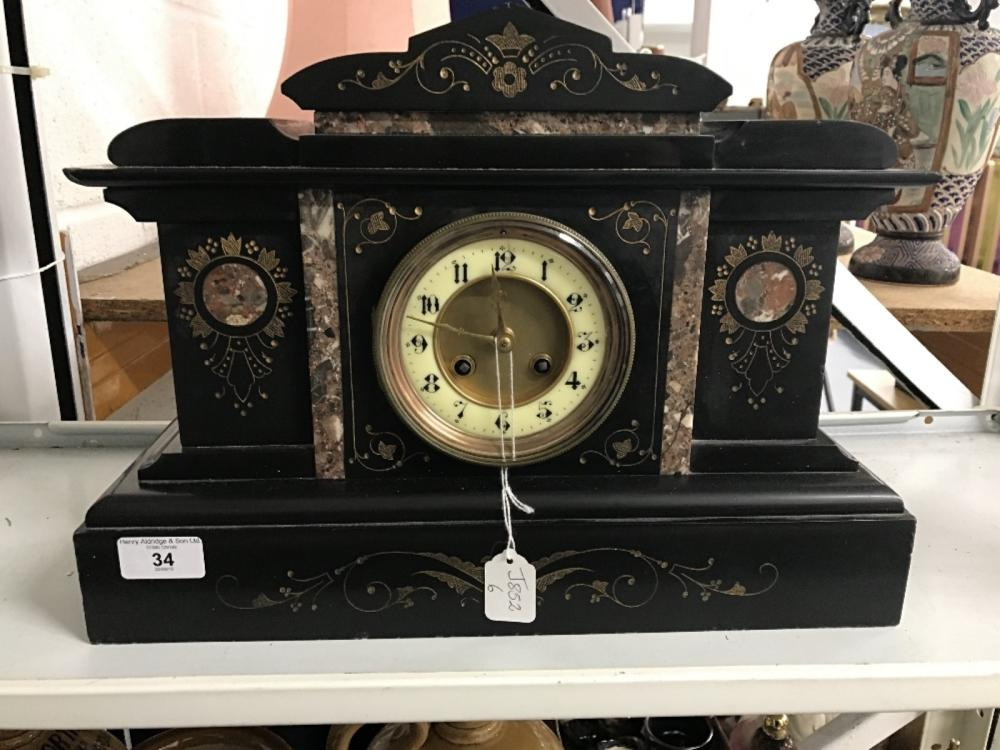 Clocks: 19th cent. Victorian mantel clock in the new classical style. Black marble with coloured inl