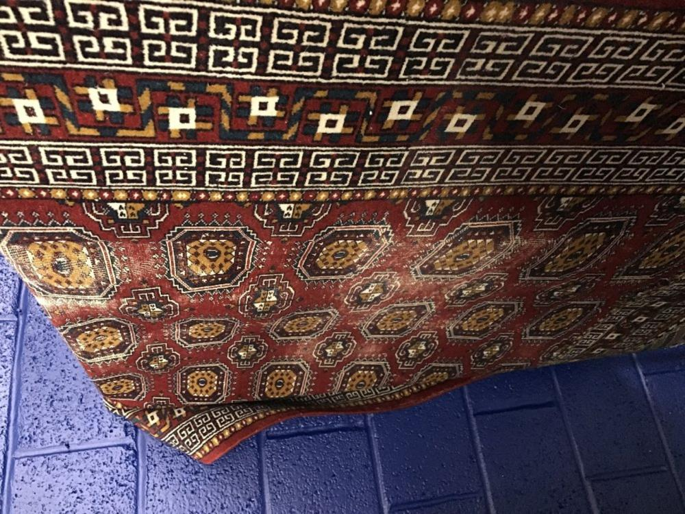 Rugs: 20th cent. Large Bokhara, red ground with 43 gils, 3 borders with 2 guard borders. Stylised ge