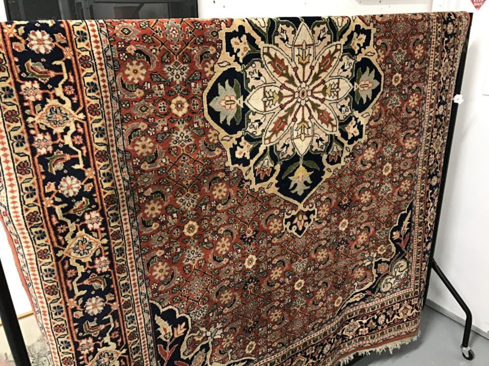 Carpet: 20th cent. Indo-Persian, red ground with stylised flowers in reds, blues, ivories, whites an