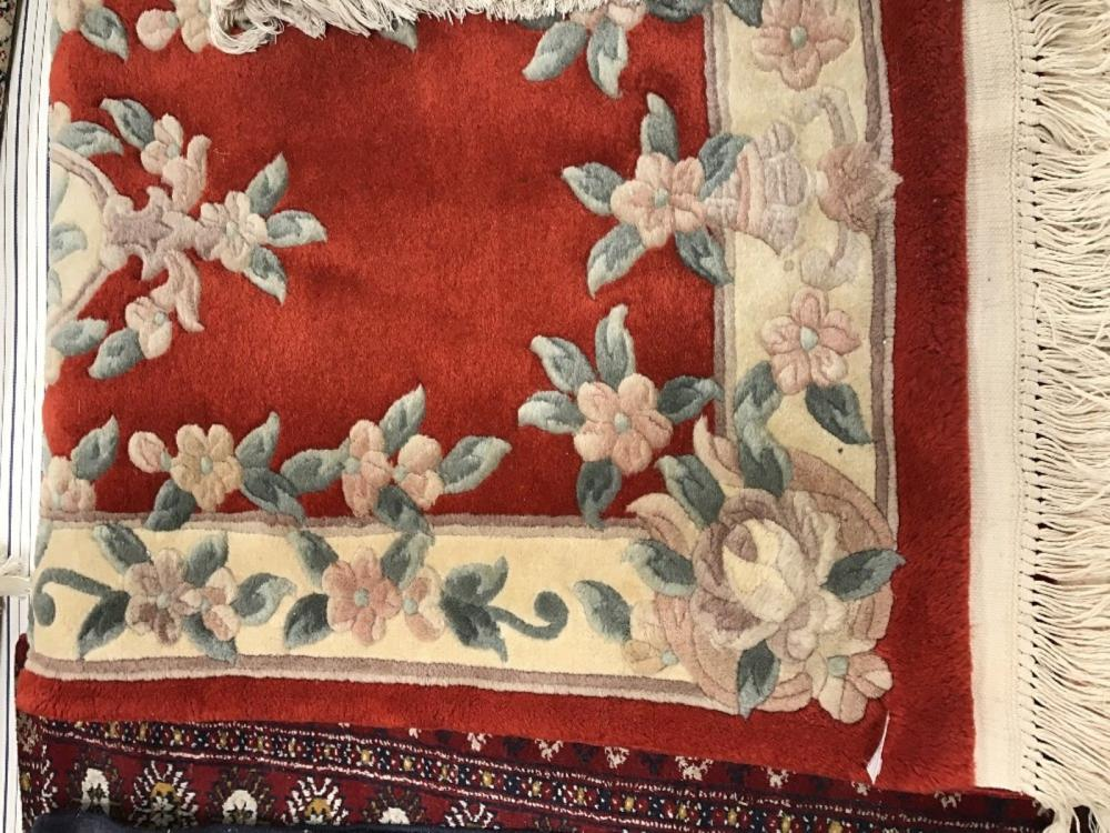 20th cent. Rug: Chinese red floral patterned. 55ins. x 27ins.