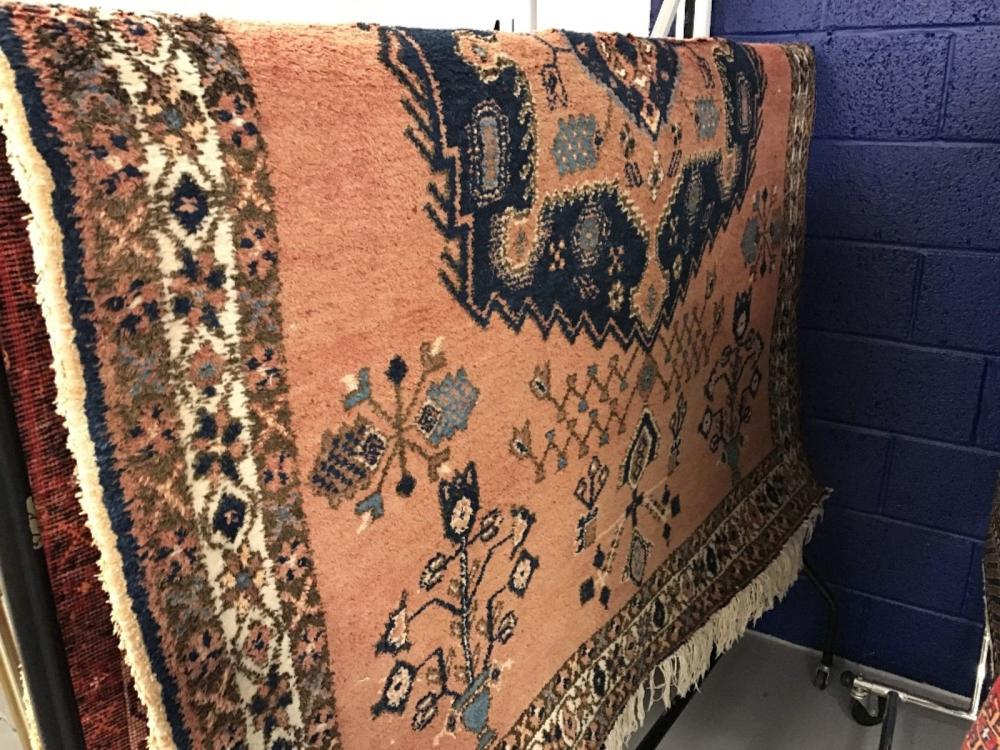 20th cent. Carpet: Red/blue patterned 83ins. x 65ins.