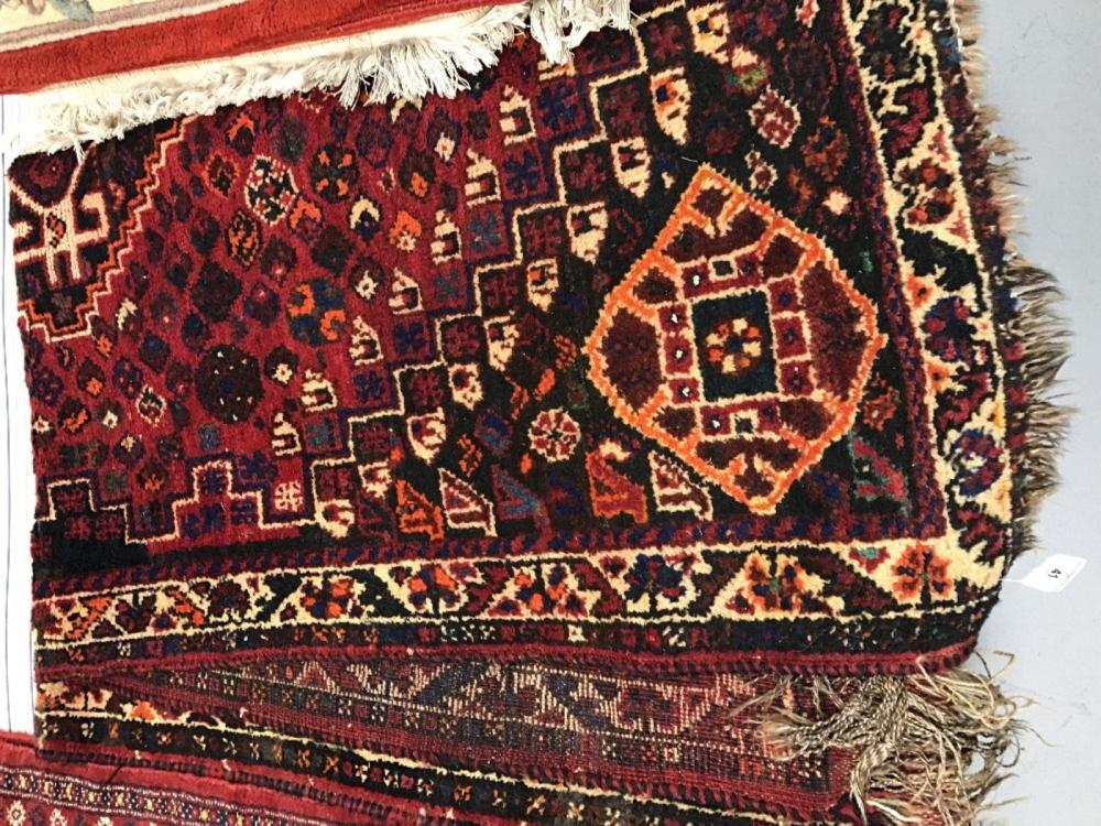 20th cent. Rug: Persian Shiraz red/orange patterned. 65ins. x 44ins.