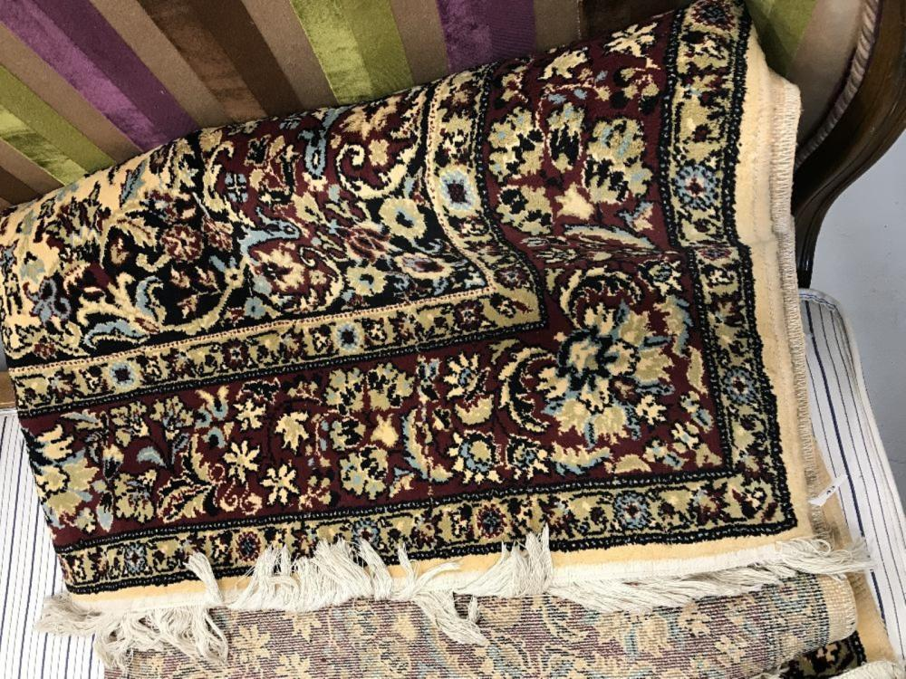 20th cent. Rug: Romanian beige/burgundy/blue patterned. 95ins. x 66ins.