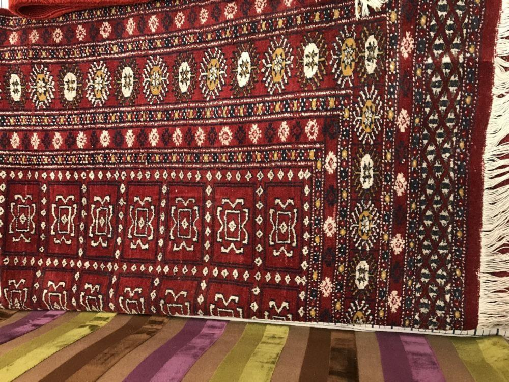 20th cent. Rug: Iranian with dark red background and yellow/white pattern. 74ins. x 50ins.