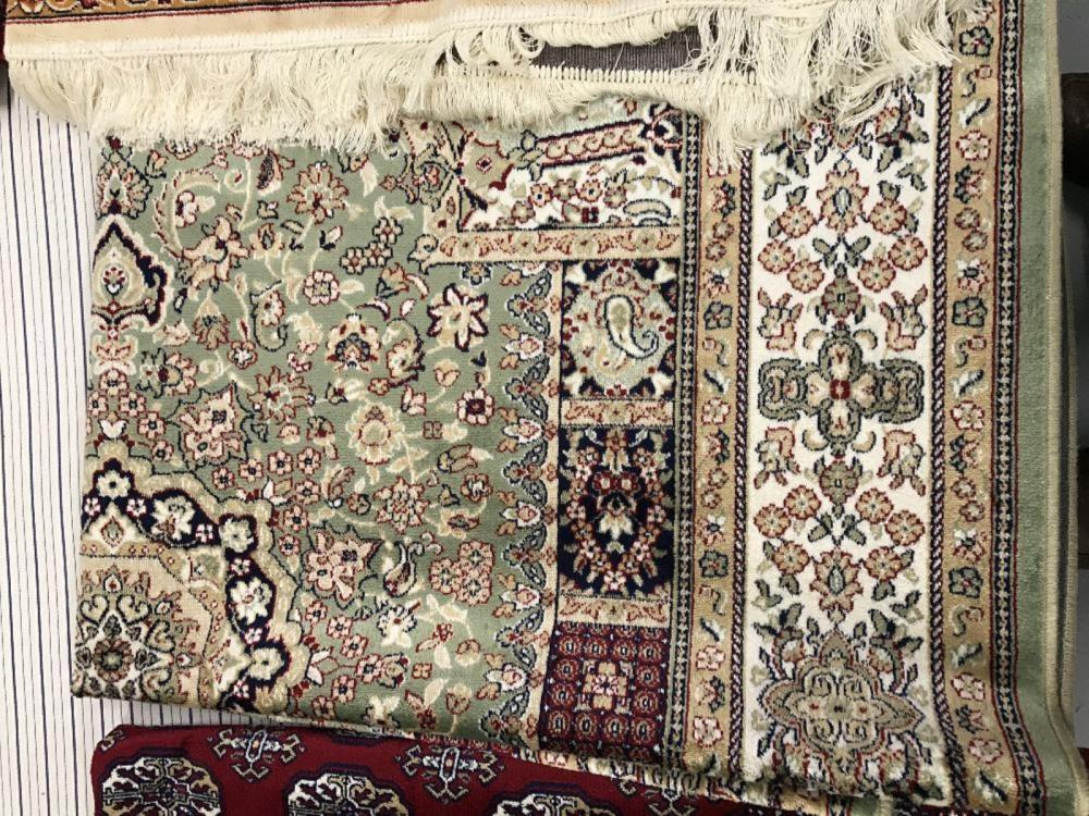 @21st cent. Carpet: Keshan, green ground with blues, reds, and ivory. Three borders. 2.3m. x 1.6m.