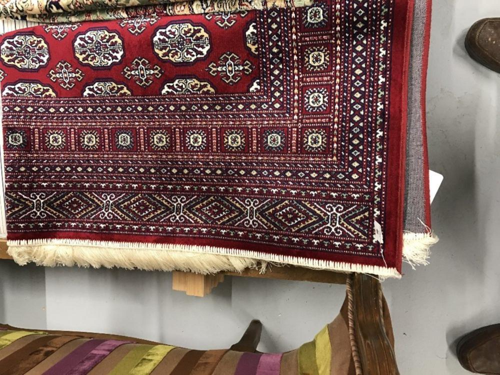 @21st cent. Rug: Bokhara, red ground with stylised geometric designs in reds, blues, ivory and white