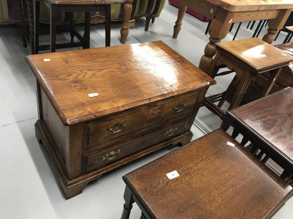 20th cent. Oak and elm television cabinet, two drop leaf openings. 32ins. x 19ins. x 20ins.
