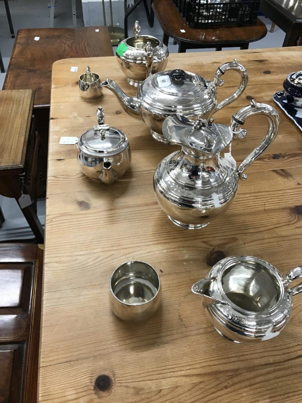Platedware: Sheffield Britannia metal tea service of teapot, hot water jug, milk jug, and sugar bowl
