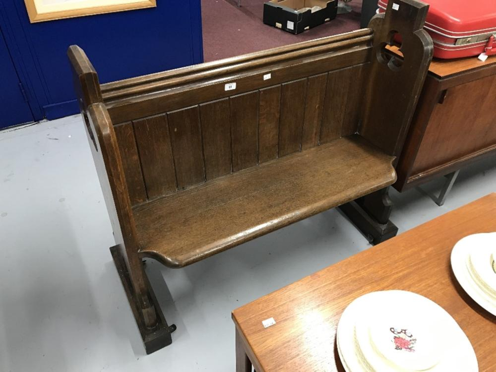 Late 19th/early 20th cent. Two seater oak church pew.