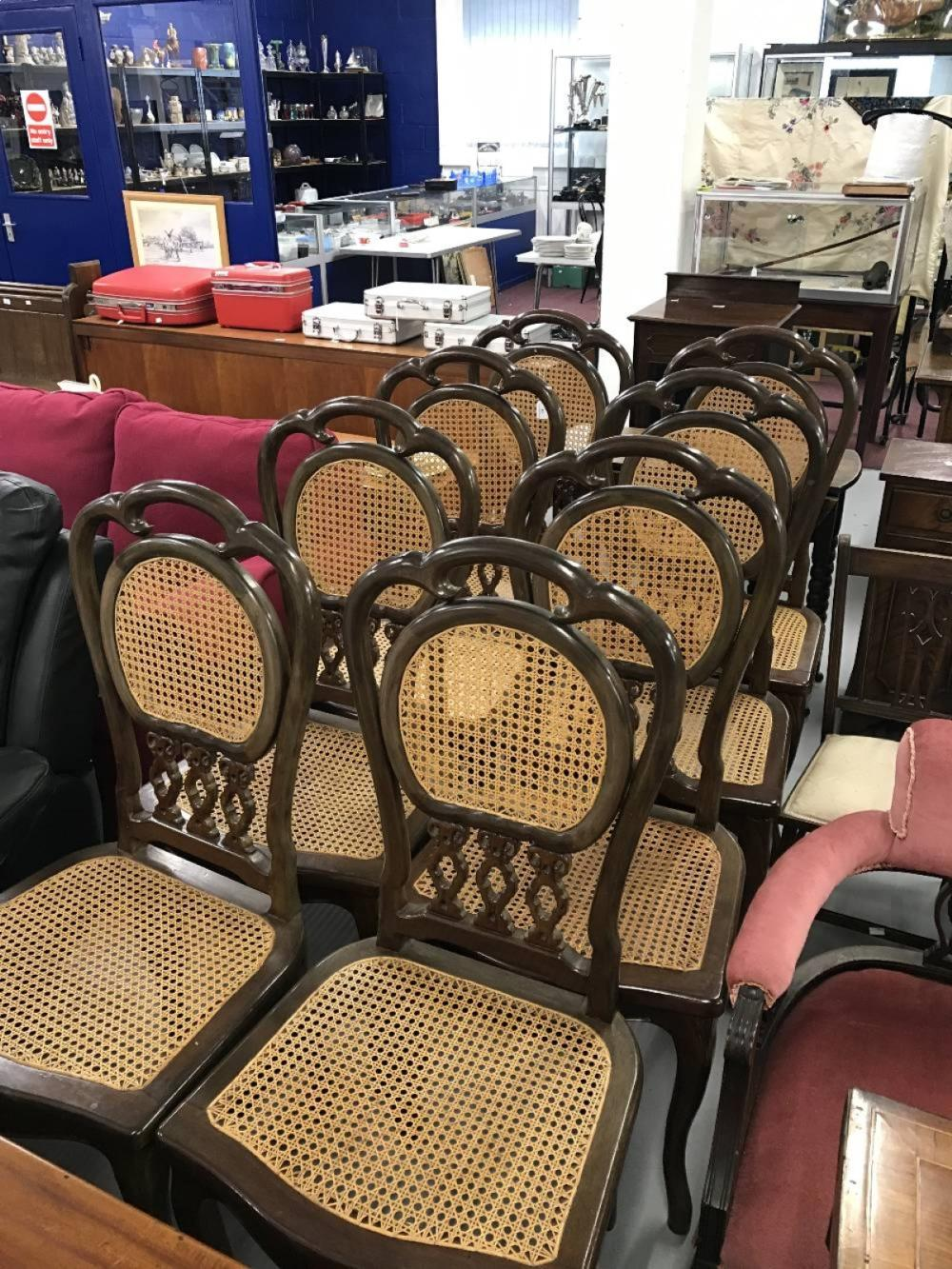 20th cent. Chinese hardwood and rattan dining chairs x 8.