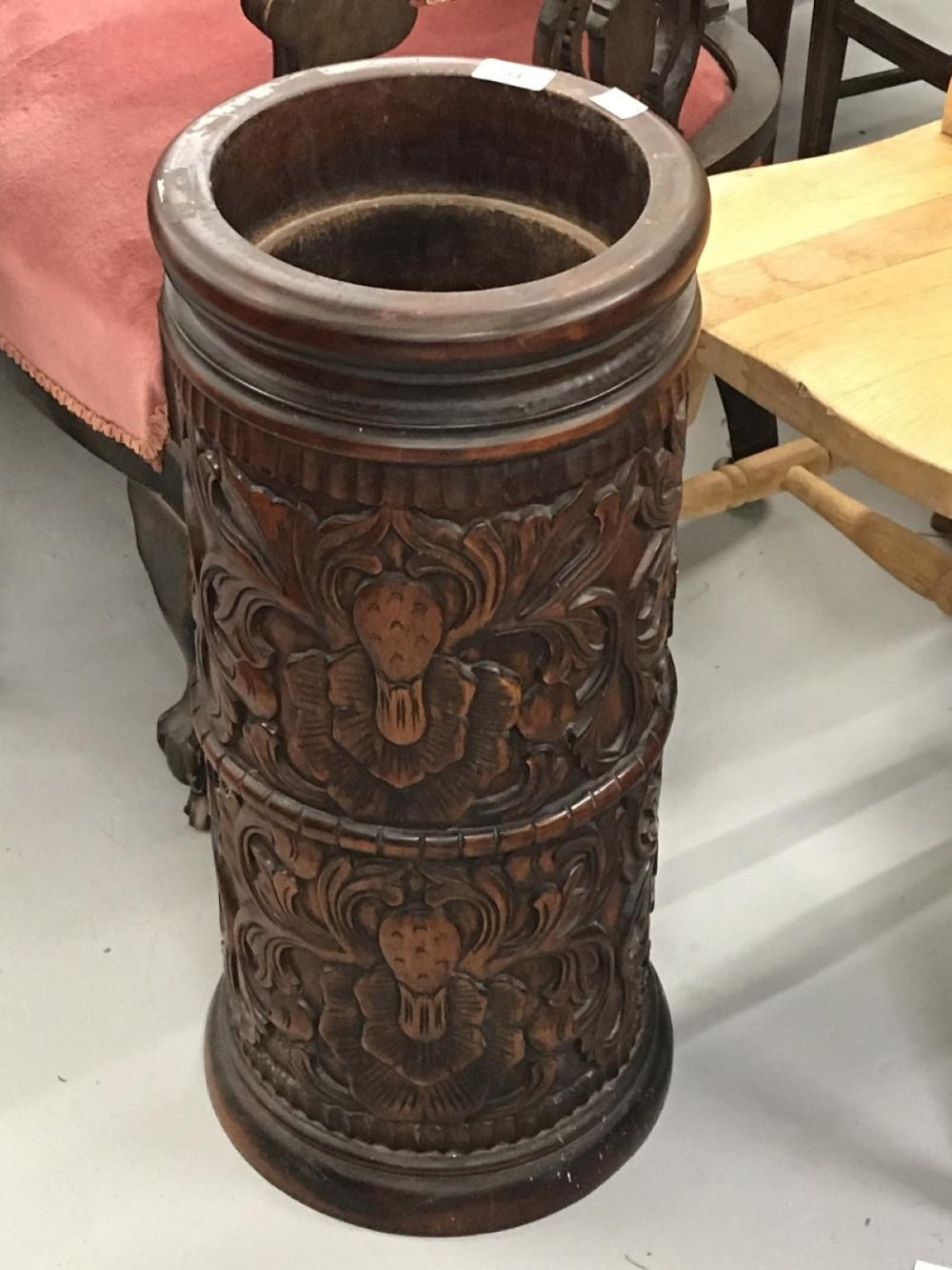 20th cent. West Indian, heavily carved mahogany stick umbrella stand. 24ins. high.