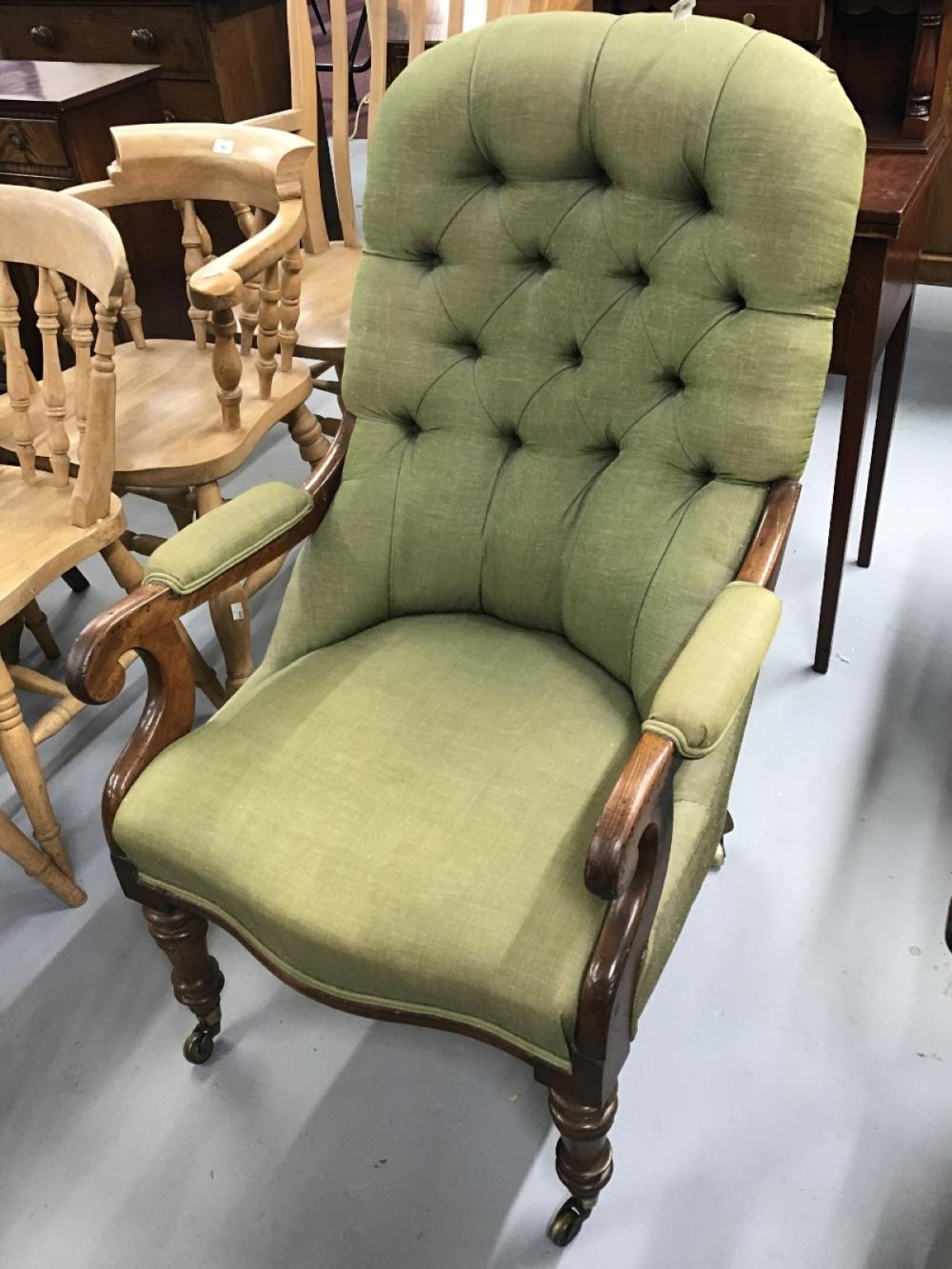 19th cent. Mahogany upholstered library chair with padded elbow rests. (1 arm a/f.)
