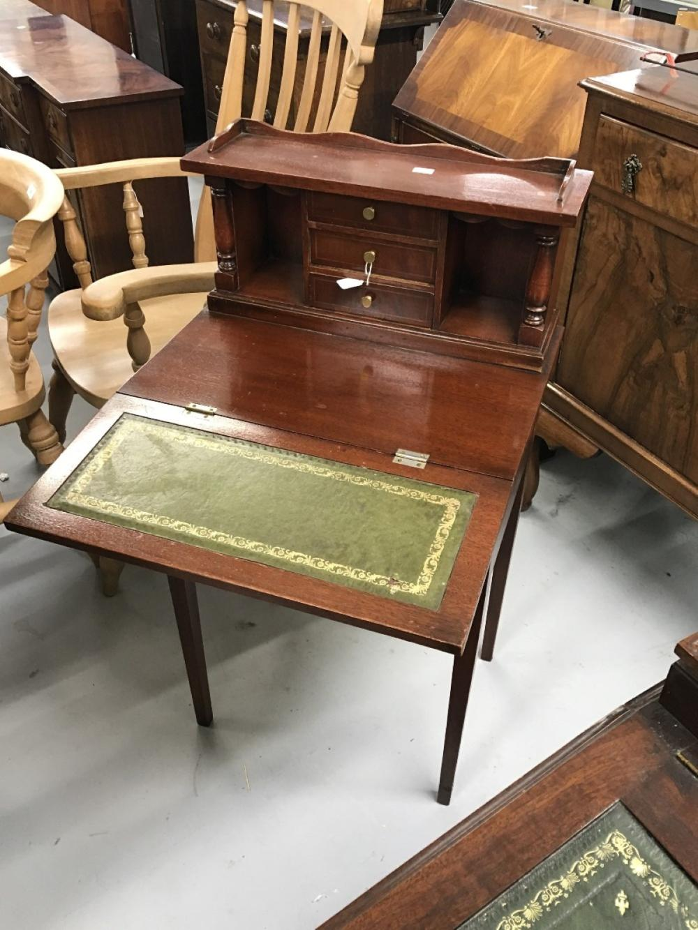 20th cent. Mahogany ladies desk. Pigeon holes and drawers above two drawer base and fold-out writing