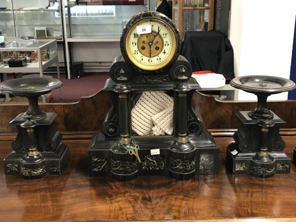Clock: 19th cent. Victorian marble mantel clock with garniture in the New Classical style.