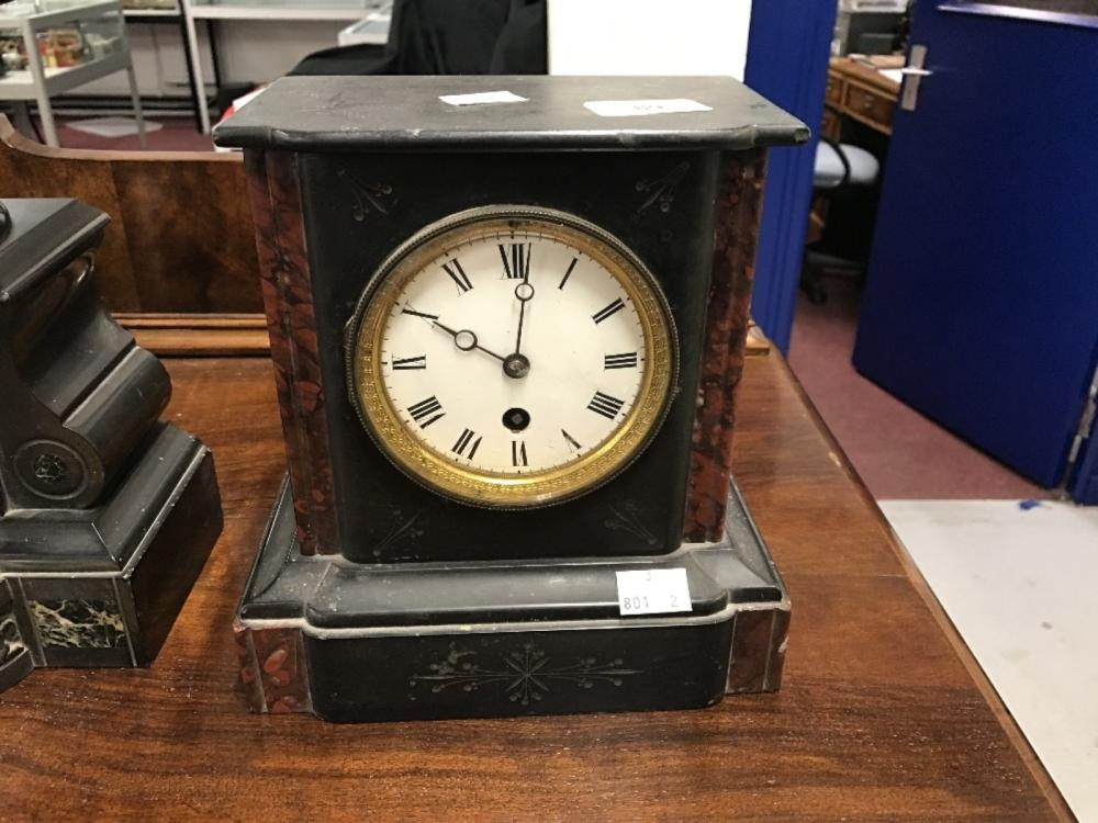 Clock: Slate and marble mantle clock. Enamel face with Roman numerals, unmarked movement. 9ins. x 8i