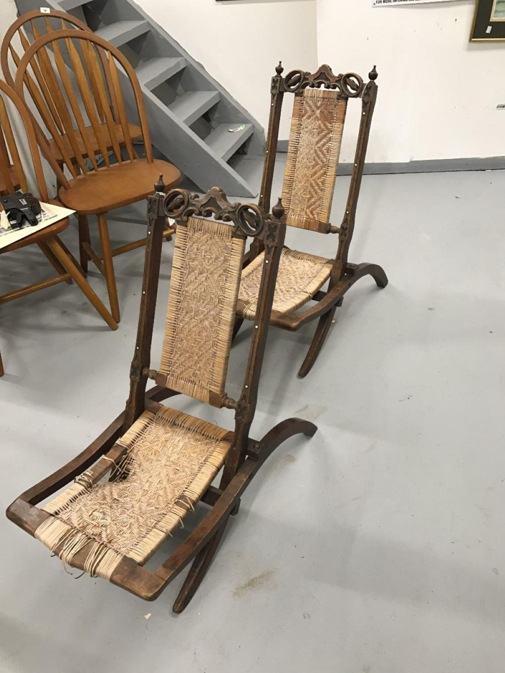 19th cent. French mahogany picnic/lawn folding chairs. Rattan seated and backed, the frame carved an