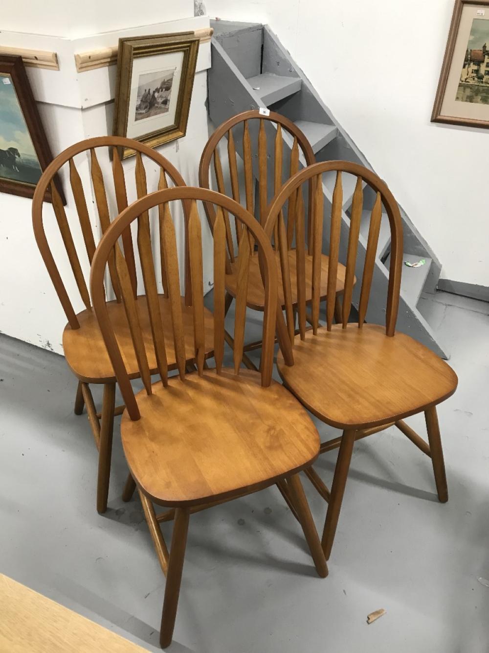 20th cent. Teak dining chairs, stick backs x 4.
