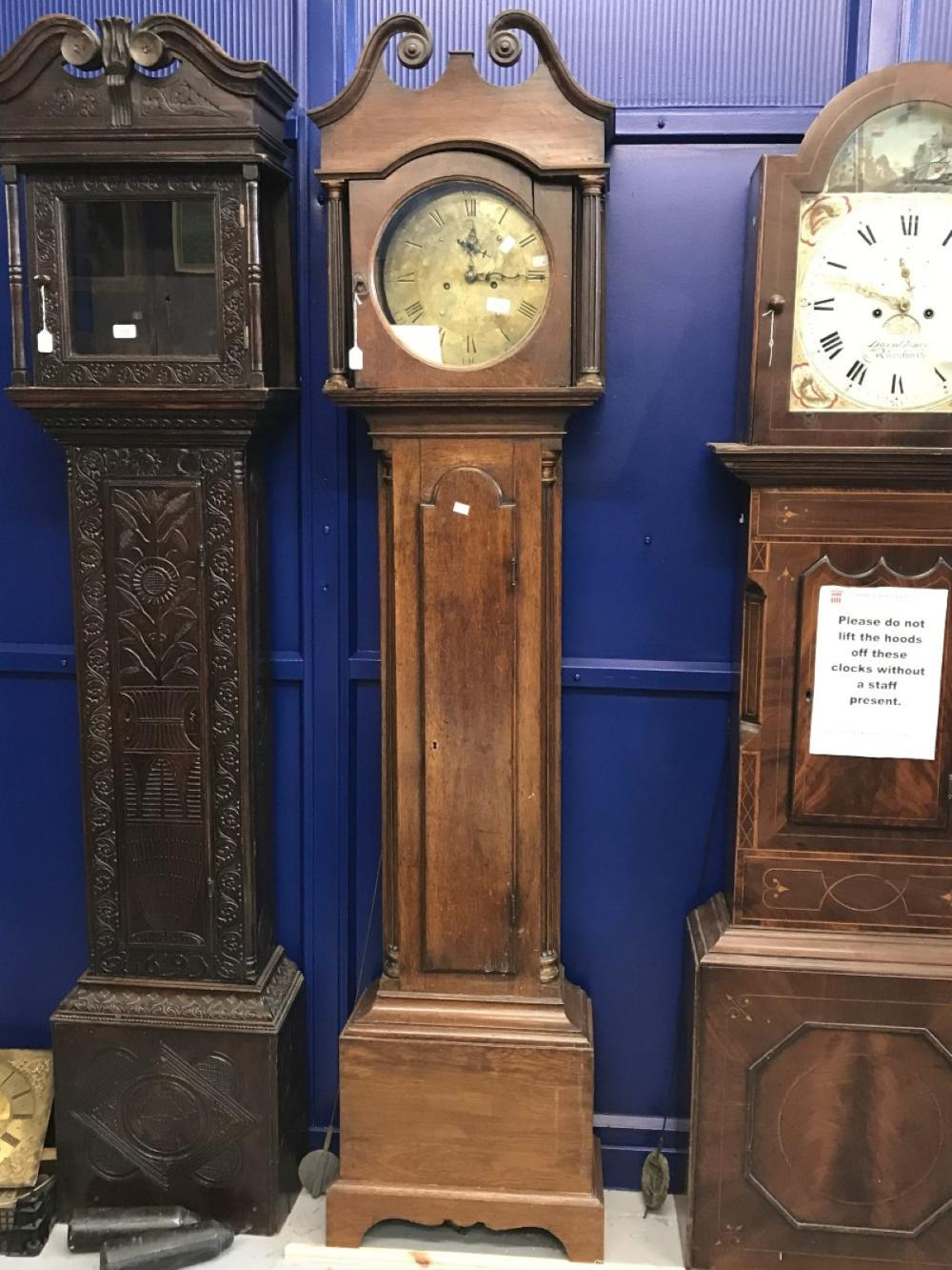 Clock: Early 19th cent. Oak eight day longcase clock. Circular brass dial. Thomas Edwards of Castor.