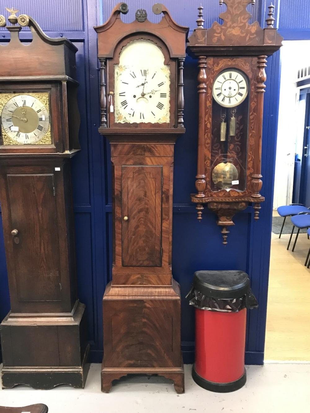 Clock: 19th cent. Flame mahogany longcase clock. Painted arch dial, floral spandrels, dome top with