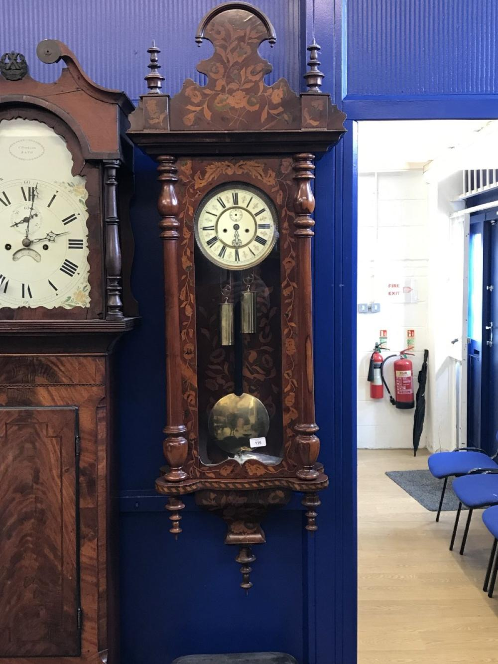 Clock: 19th cent. Continental Dutch style hanging wall clock. The interior and exterior case inlaid