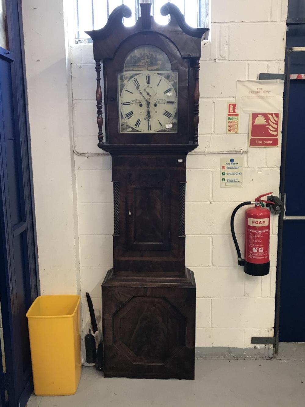 Clock: 19th cent. Mahogany longcase clock. Arch dial, painted rural scene  spandrel bell strike seco