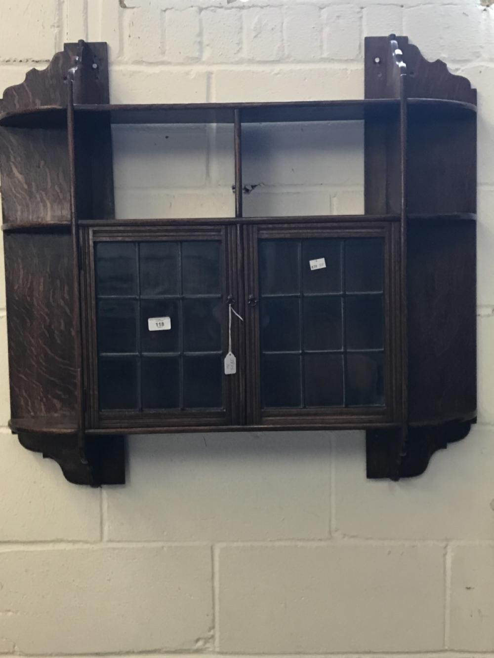 Early 20th cent. Oak wall hung display cabinet with 9 shelves and 2 leaded glass doors.