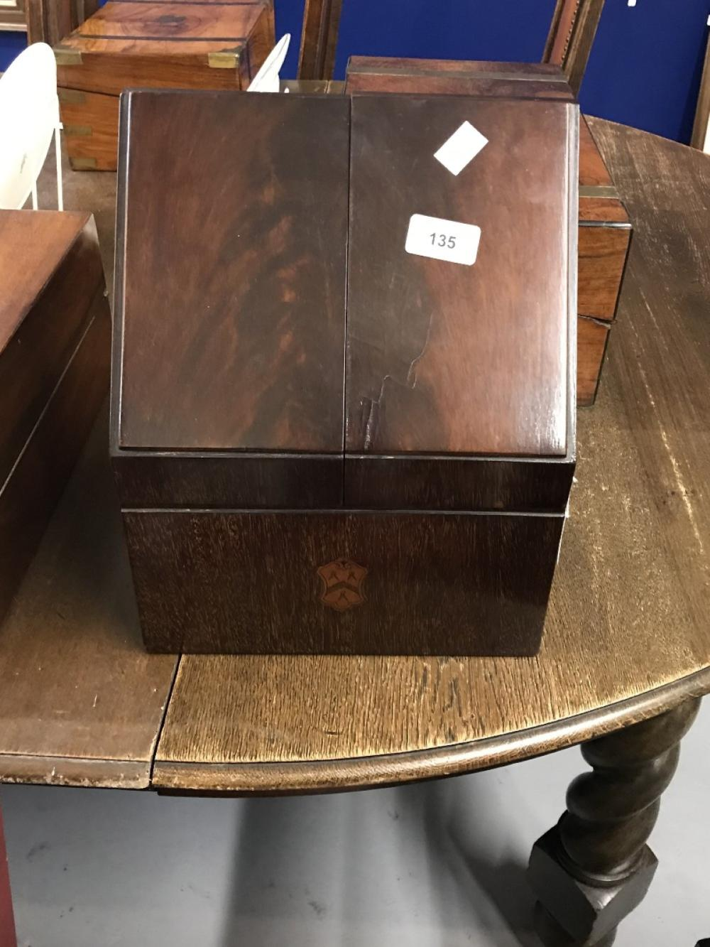 Boxes: 20th cent. Mahogany stationery box with Armorial to the front.