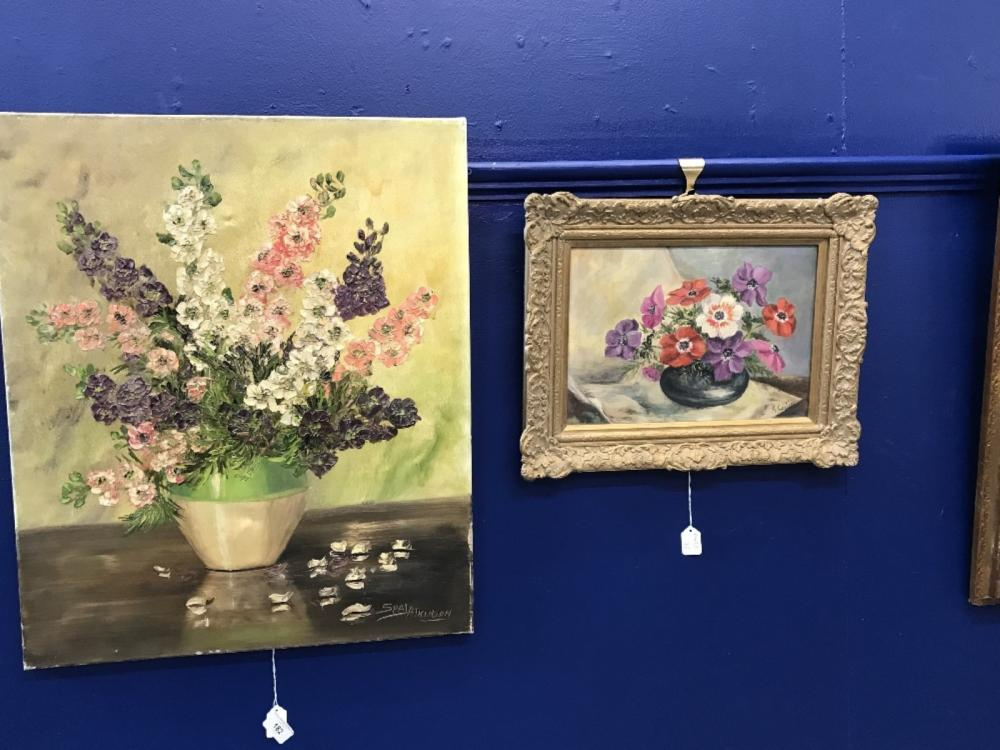 S Atkinson: Oil on canvas still life of flowers in a vase, signed lower right, unframed 19¾ins. x 23