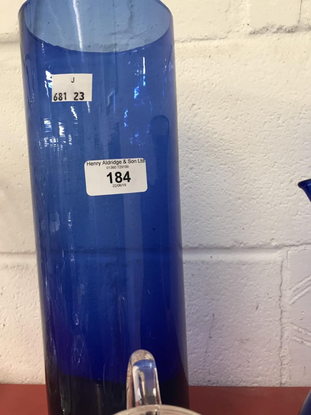Glassware: 19th cent. Blue glass water jug 9ins. 20th cent. Trumpet vase 11½ins, tall cylindrical va