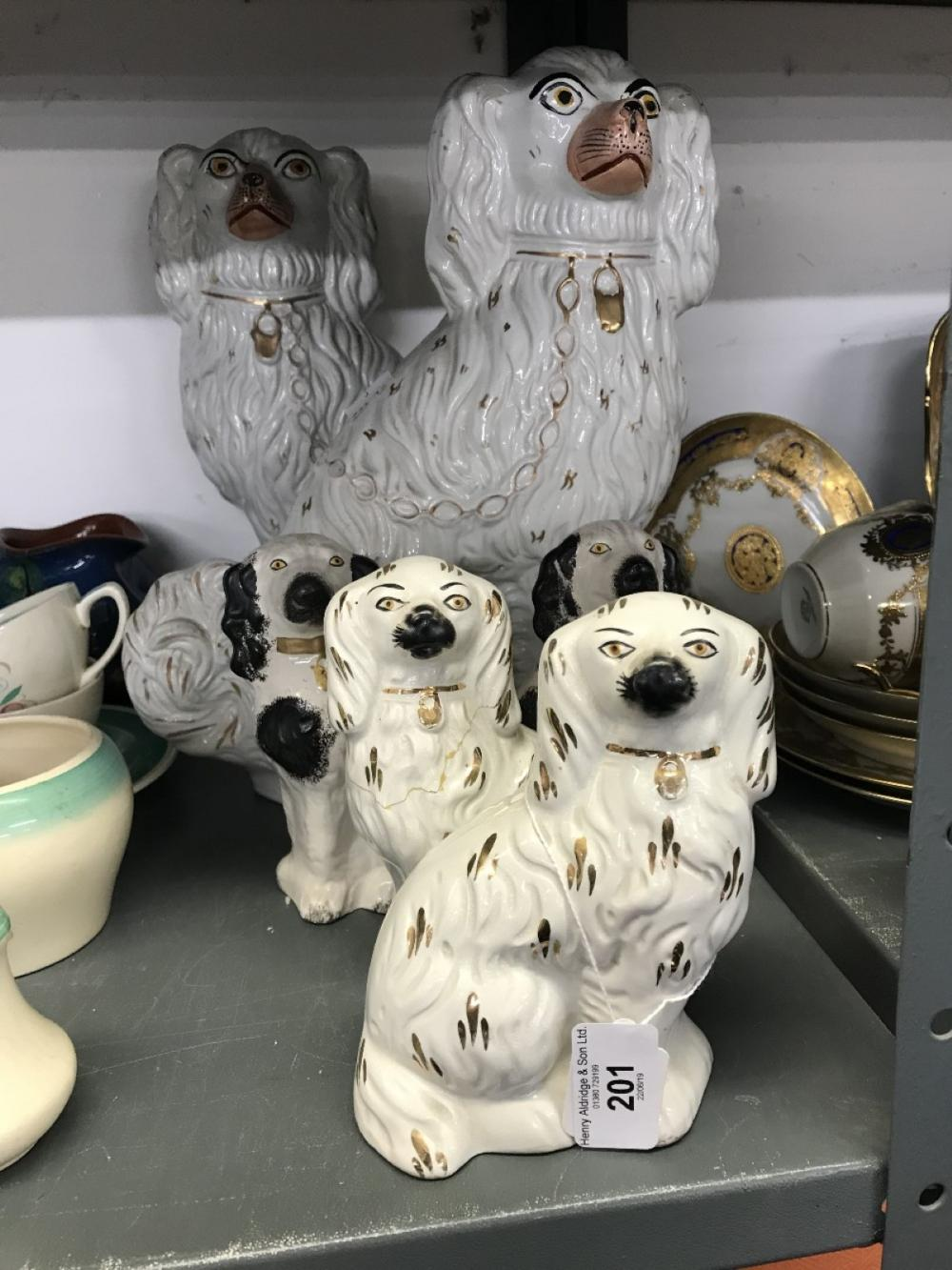 19th/early 20th cent. Ceramics: Staffordshire comfort dogs with white gilt decoration - a pair. 12in