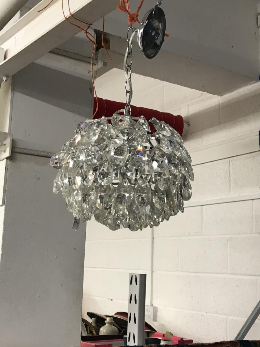 20th cent. Chrome and glass chandelier with diamond cut drops shaping the light to a globe form.