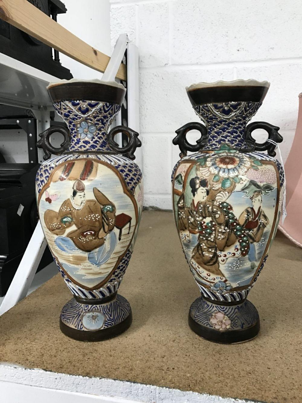 20th cent. Oriental: Vases with painted panels of figures, male & female - a pair. 12ins.