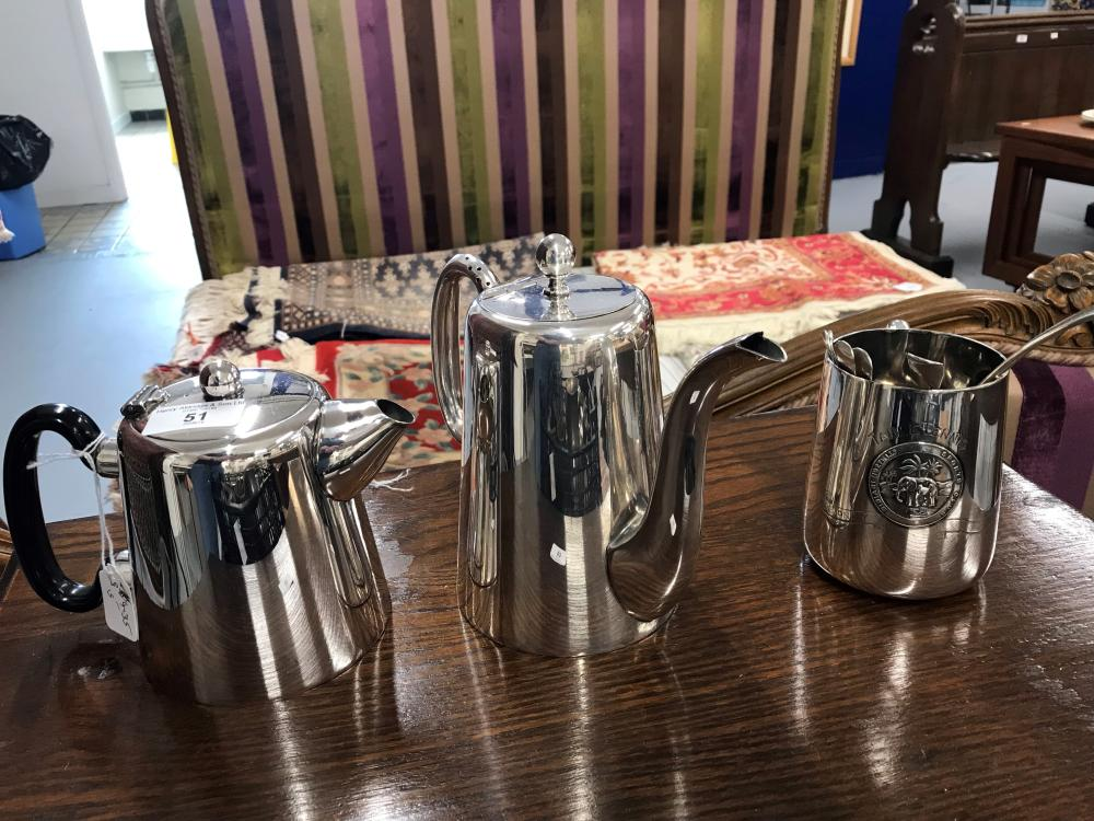 Platedware: Coffee, tea pot, tankard, ladle, napkin holder and 5 teaspoons.