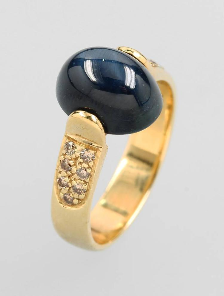 14 kt gold ring with star sapphire and brilliants