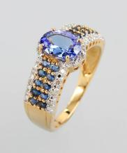 14 kt gold ring with tanzanites and sapphires and diamonds