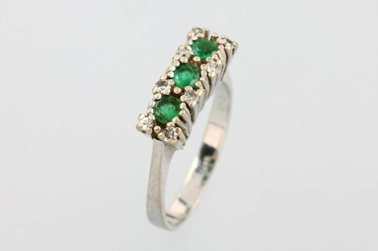 14 kt gold ring with emeralds and diamonds
