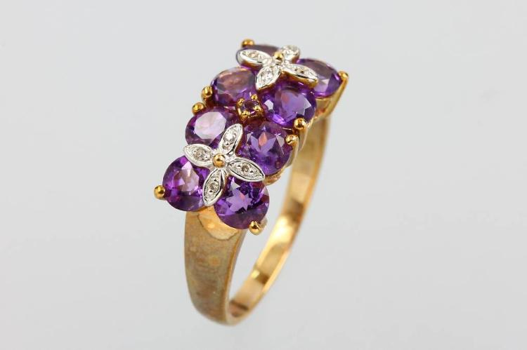 9 kt gold ring with amethysts and brilliants