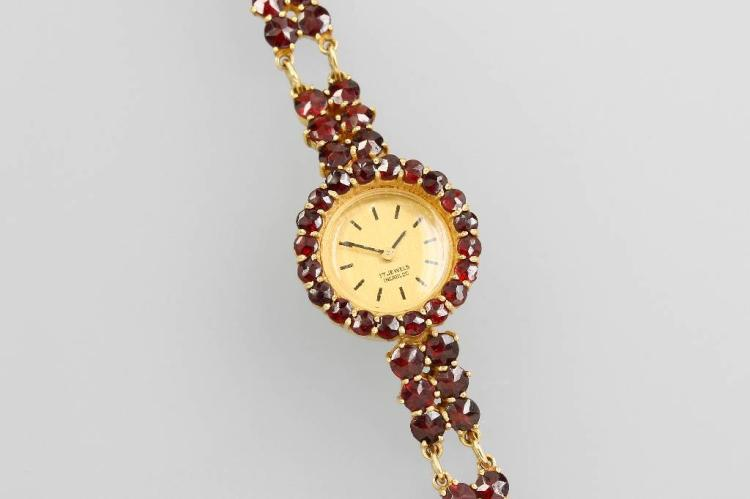 8 kt gold ladies' wristwatch with garnets