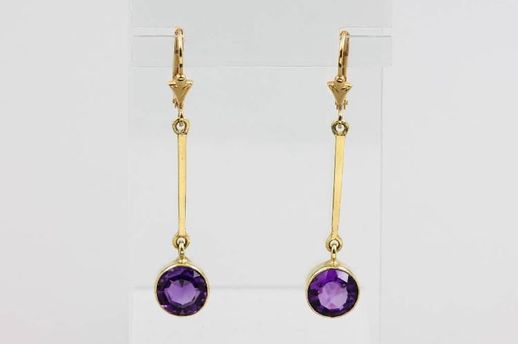 Pair of 14 kt gold earrings with amethysts