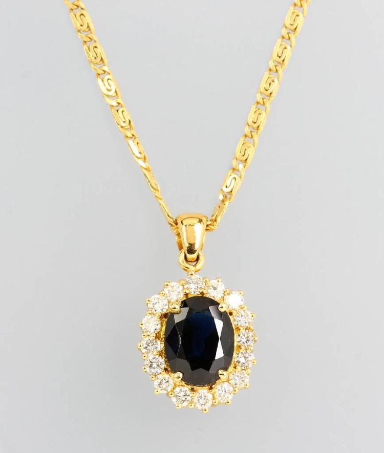 18 kt gold pendant with sapphire and brilliants