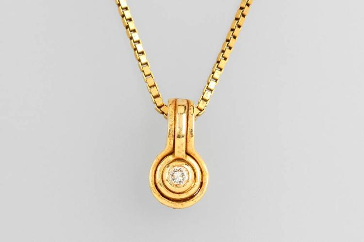 18 kt gold pendant with brilliant