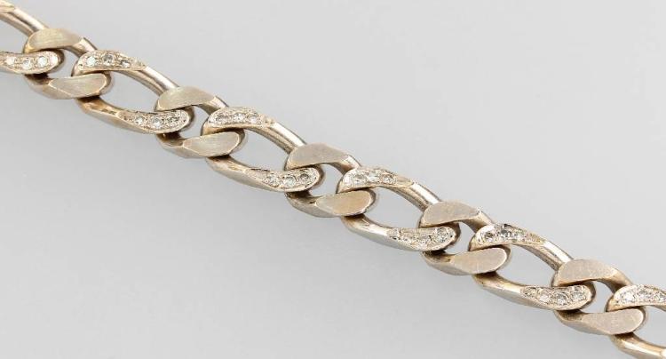 18 kt gold flat curb bracelet with diamonds